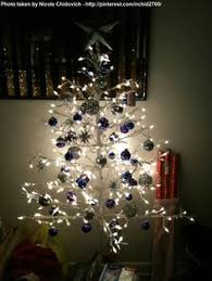 An outdoor, wire, pre-lighted Christmas tree also looks fantastic indoors!