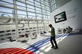 google san francisco office tour. a google logo is seen through windows of moscone center in san francisco office tour