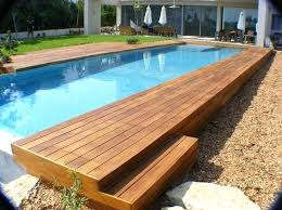 rectangle above ground pool sizes. Delighful Above Above Ground Rectangular Pool Swimming  Infinity With Wooden Deck And Umbrella   With Rectangle Above Ground Pool Sizes E
