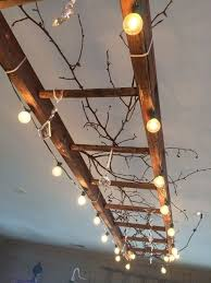 diy home lighting. use patio lights and a old ladder to make statement ceiling light fixture diy home lighting