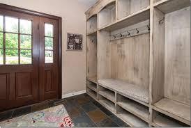 Traditional Entryway with Carpet, High ceiling, Built-in bookshelf, slate  tile floors