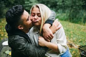 cute young couple kissing and hugging by kkgas for stocksy united