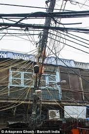 power cables in old delhi dangle perilously close to the residents old delhi 30 electrical wires seen dangling over a house at