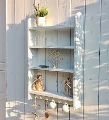 white wall shelves with hooks for
