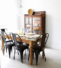 all wood dining room chairs. matte black chairs with a rustic, wooden table from pineapple life (via design* all wood dining room g
