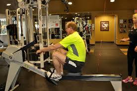 Dr. William Huffaker on rowing machine.