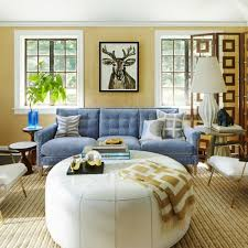 sofa blue white coffee table sisal carpet yellow walls