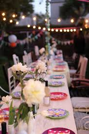 Decorations:Outdoor Garden With Long White Table With White Table Cloth And  Colorful Plates With