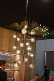 porcelanosa s kitchen display included this mod kitchen light fixture the round glass barbell like