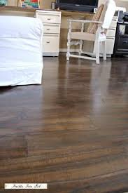 wood plank floor using brown paper freckle face for remodelaholic
