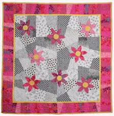 22 best Quilting - Stack and slash images on Pinterest   Block ... & Feelin' Hot Hot Pink: A modified stack and slash forms the background of  this quick and striking quilt. Machine appliqued flowers and a fun border  design ... Adamdwight.com