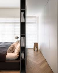 wardrobe right behind a tall bed with side storage for bookagazines