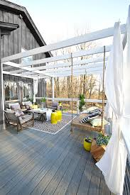 deck makeover with hanging bench privacy curtainore