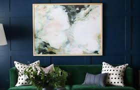 design room with olive green sofa black