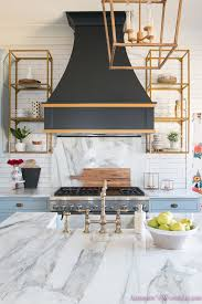 kitchen white marble calcutta gold open shelves gold black vent hood blue gray cabinets shaker style black chevron tile subway white backsplash decor ideas