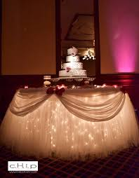 wedding cake table - love the lights under this and the tulle table skirt