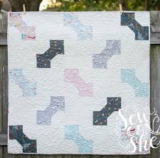 Bow Tie Baby {free quilt pattern} easy, easy, easy! — SewCanShe ... & And now I'm finally ready to share with you a pattern for the quilt that I  made out of my bow tie blocks! This easy baby quilt finishes at 40'' square. Adamdwight.com