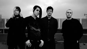 Black and white photo of all four members of AFI looking at the camera.