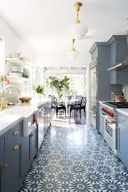 Modern dec kitchen with bloue cabinets, printed tile and gold hardware. |  Emily Henderson  Open Galley ...