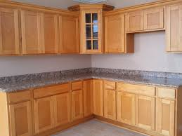 kitchen brown wooden corner kitchen pantry cabinet with grey marble countertop on ceramics flooring and