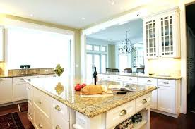 tan granite countertops kitchen contemporary with transitional dark cabinets desert