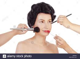 makeup arists preparing model for photo shoot isolated on white