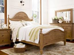 Cute French Country Bedroom With Wood Furnishing And An Oriental