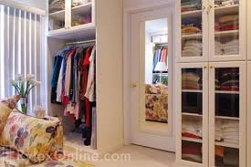 walk in bedroom closet cabinets with full glass doors