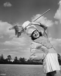 Muriel Smith as drum majorette, raising baton in her hand. News Photo -  Getty Images