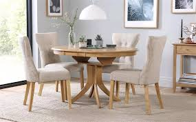 round oak extending dining table and chairs