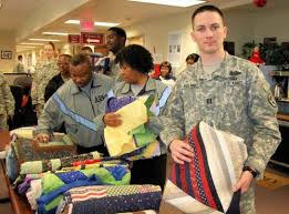 Blackberry Hill Quilts - Quilts of Valor & Soldiers at Fort Brag picking out their quilts. Adamdwight.com