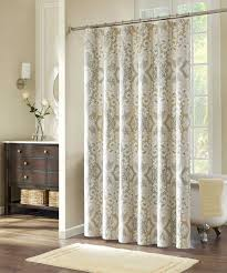 patterned fabric shower curtains with stainless steel rod connected by grey wall and white bathtub on