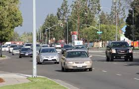 file photo cars travel on shaw avenue in fresno