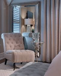 in a corner of the master bedroom a shingle chair and small side table adds comfort to the space note light reflectance generated by placement of the