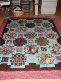 Another quilt with small squares framing large squares. Great for ... & I made thsi quilt from scraps using a pattern called Focus Pocus by Swirly  Girl designs.I LOVE>>>LOVE>>>>LOVE their patterns! Adamdwight.com