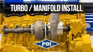 How to Install: PDI Turbo & Exhaust Manifold - CAT C15 - YouTube