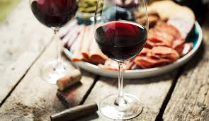 glass of red wine with food