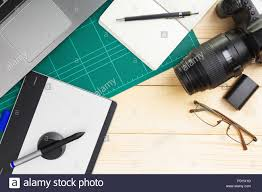 Graphic Designer Stuff Top View Of Office Stuff And Gadgets On Wooden Desk With