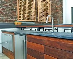 image of a contemporary outdoor kitchen with wooden panels sink and fridge uk custom