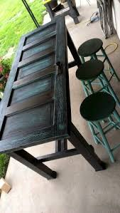 old door bar table like the look but would top with gl or resin