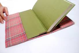 sew a fabric book cover add handles to both sides and elastic on both inside side for smaller books or notepad