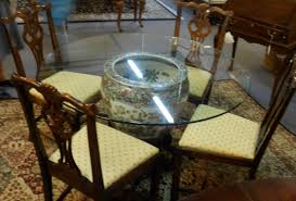 interesting design of dining room table base offering round glass dining table and brown wood chairs