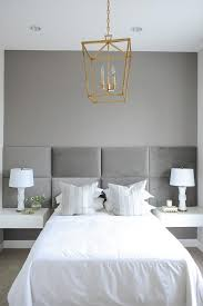 white and gray bedroom with white floating nightstands