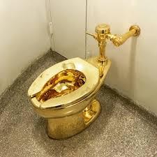 gold toilet. gold toilet