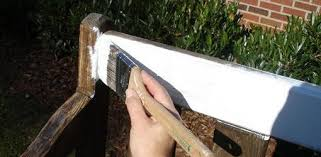 wood furniture in the garden bench being painted