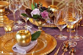 golden apple with orchid linens and a beaded glass charger