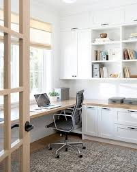 stylish home office desk. Chic First Floor Home Office Features To Ceiling White Built-in Shelves, Cabinets And Drawers Illuminated By A Frosted Glass Jar Lantern. Stylish Desk O
