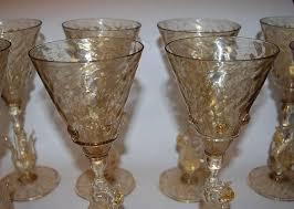 a wonderful set of handblown venetian glass liquor glasses this set of six features elegant