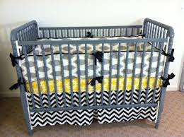 elegant gray davinci jenny lind crib made of wood with charming bedding before the white wall charming baby furniture design ideas wooden