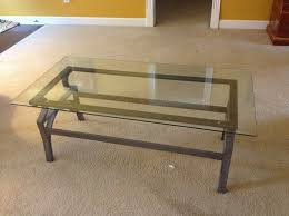 creative diy coffee table with custom cut piece of glass and yellow wall